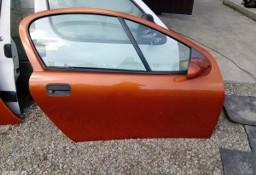 Drzwi prawe przednie kompletne Opel Tigra A