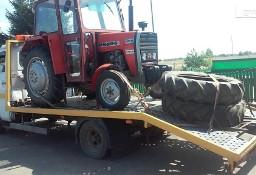 Transport maszyn rolniczych przyczep rozrzutników Stanisławów laweta