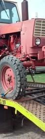 Transport lawetą maszyn rolniczych przyczep rozrzutników i innych-3